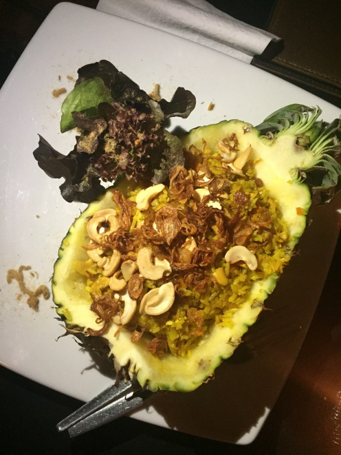 Stir-fried rice and chicken inside a pineapple